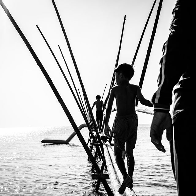 Another outtake from Phu Quoc over the weekend for a quick assignment. Boys play on a bamboo pier on the island's well know Long Beach stretch. #vietnam #phuquoc #island #onassignment #vietnamcharm #discovervietnam #tinypeopleinbigplaces  #bestplacestogo  #cityview  #travelphotographer #traveldeeper #letsgosomewhere  #moodygrams  #passionpassport #ourplanetdaily #sonya7riii #sonyalpha #sonyimage @sonyalpha @sonyvietnam