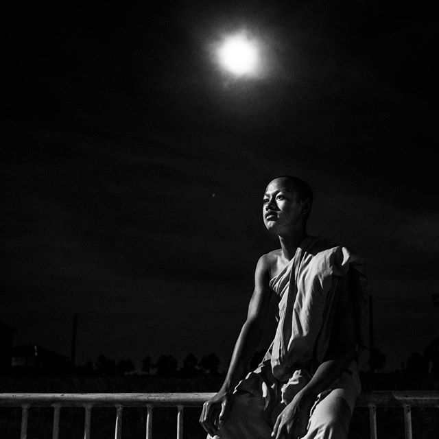Let's go from color to black and white and sunset to moonset…. A novice monk in portrait in Soc Trang Province, Mekong Delta region, Vietnam. #vietnam #soctrang #monk #moonlight #vietnamcharm #discovervietnam #tinypeopleinbigplaces  #bestplacestogo  #cityview  #travelphotographer #traveldeeper #letsgosomewhere  #moodygrams  #passionpassport #ourplanetdaily #sonya7riii #sonyalpha #sonyimage