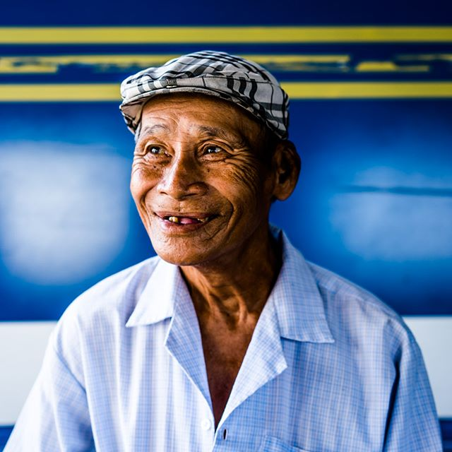 Here's a smile to get you started on Monday morning! A man on a ferry as I traveled through the Mekong delta this weekend on a private photo tour with @mpapaeracleous and @saigonphototours  As I wandered the ferry looking for a character (and they're always are a few!), this lovely gentleman said hello to me before I could him, and I knew we had to make a frame. I quickly scramble to find the angle, outside was too bright, and the inside too busy with cars. Then I come around to parallel with him, and notice the beautiful blue truck he's standing in front of. Boom, there was my background, perfect!  Much more of the Mekong to come this week…. #vietnam #vietnamcharm #discovervietnam #tinypeopleinbigplaces  #bestplacestogo  #cityview  #travelphotographer #traveldeeper #letsgosomewhere  #moodygrams #portraitphotography #portraitperfection #portraitoftheday #makeportraits #pursuitofportraits #discoverportrait #portrait_perfection  #passionpassport #ourplanetdaily #sonya7riii #sonyalpha #sonyimage @sonyalpha @sonyvietnam