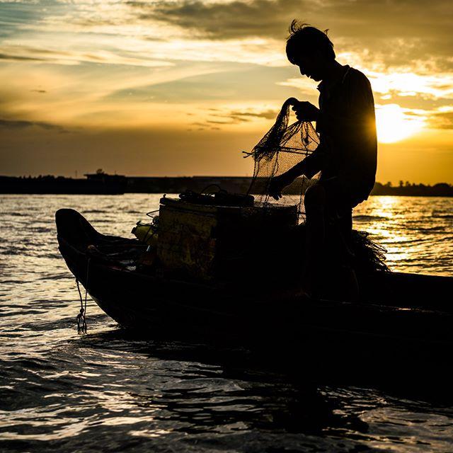 A fisherman tends his nets at sunrise near Long Xuyen, Mekong Delta, Vietnam.  #vietnam #mekongdelta #mekong #floatingmarket #boats #sunrise #poetry #vietnamcharm #discovervietnam #tinypeopleinbigplaces  #bestplacestogo  #cityview  #travelphotographer #traveldeeper #letsgosomewhere  #moodygrams  #passionpassport #ourplanetdaily #sonya7riii #sonyalpha #sonyimage
