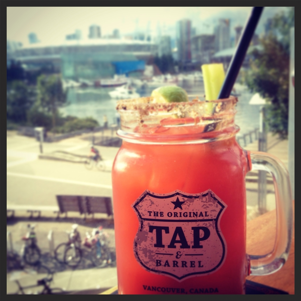 @Tap&Barrel, Olympic Village, Vancouver, BC, Canada.  A bit watery in the clamato juice, and no pickled veggies. Just a celery stick, cute mason jar with a handle and a killer view of false creek. Worth it to just sit on the patio and enjoy the sunshine and view, but next time may enjoy one of the hundreds of beers and wine they have on tap (& barrel).