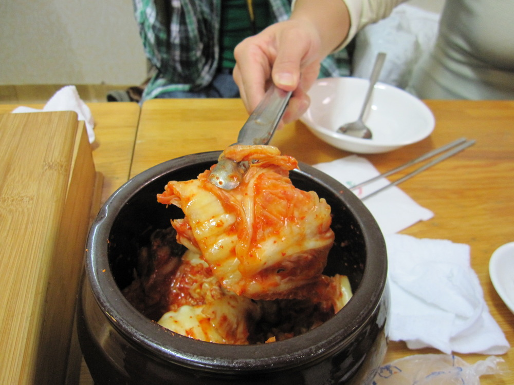 The simple and best sides to go with the soup: 깍두기 (GgakDooGee). Cubed radish kimchi, and 김치 (Kimchi). Cabbage kimchi.