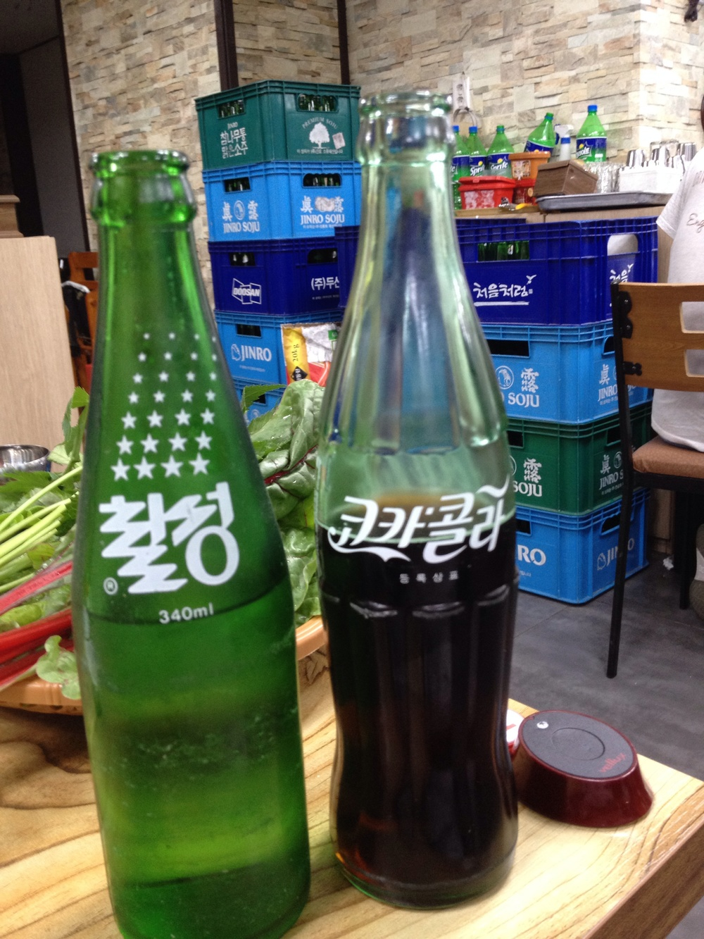 Cute old school glass pop bottles. Chilseng Cider and Coca-Cola.