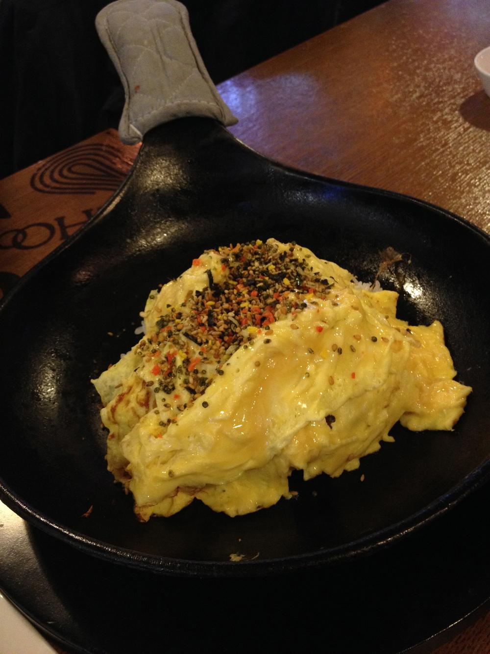 철판장조림버터비빔밥 I (ChulPan JangJoRim Butter Bibimbap) Beef and Butter Stirfried rice on a stone pan. Comes out like this...