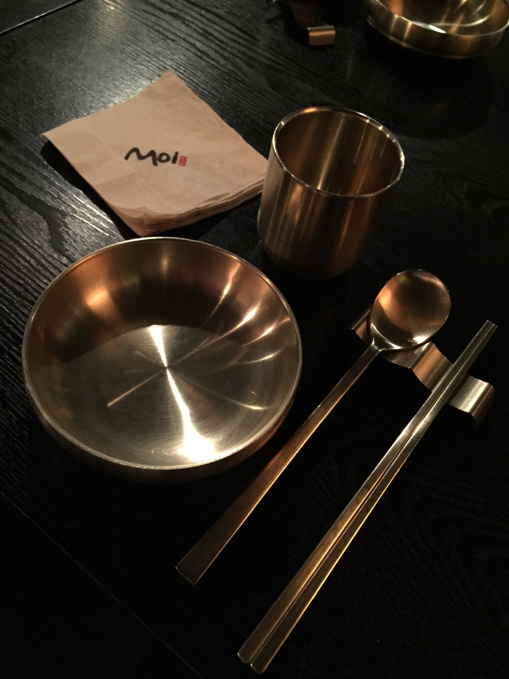 """Traditional Korean metal plates andutensils.  Apparently there are a few reasons on why Korea uses metal chopsticks: 1) In early times, the King used to use only pure silver chopsticks because if his food was poisoned, the silver would tarnishand he would be able to detect it incase someone was trying to poison him. 2)Originally, higher grade metals like silver and brass were used for the royal families, so metal chopstickssymbolises high class or are considered a valuable. 3) When there used to be many fires in the palaces, metal utensils would survive as opposed to things made out of wood.  If you enjoy random facts like this or likelearning about history, geography, culture, politics, etc of Korea, but want to learn about it in a funny comic book style format,  go to  Kyobo Bookstore  and buy  """"Korea Unmasked"""" by Lee Won Bok.  He is a famous Korean professor and cartoonist that has written many books, but this one in particular is translated into English. If you live in Korea, teach third culture kids, or have any Korean background/affiliation, Ican't recommend this informative and comicalbook enough! I am not a huge reader, but this is a must read and I learned so many fun facts about the differences between Korean, Japanese and Chinese cultures - European too actually,and why/how things have evolved the way they have.It helpedto explain so many questions I had about Korean culture and has a lot of random facts written in a hilarious page turning way! It even explains fun food relatedthings like why all the chopsticks are different styles/lengths in different Asian countries, why Korean food is strong and spicy andhow eventhatinfluences different personalities and temperments!  You can order off of the Korean Kyobo Bookstore website here:http://www.kyobobook.co.kr/search/SearchCommonMain.jsp  If you don't live in Korea, you can buy it for a higher price on Amazon here:http://www.amazon.com/Unmasked-Country-Society-Edition-Graphic/dp/8934917717"""