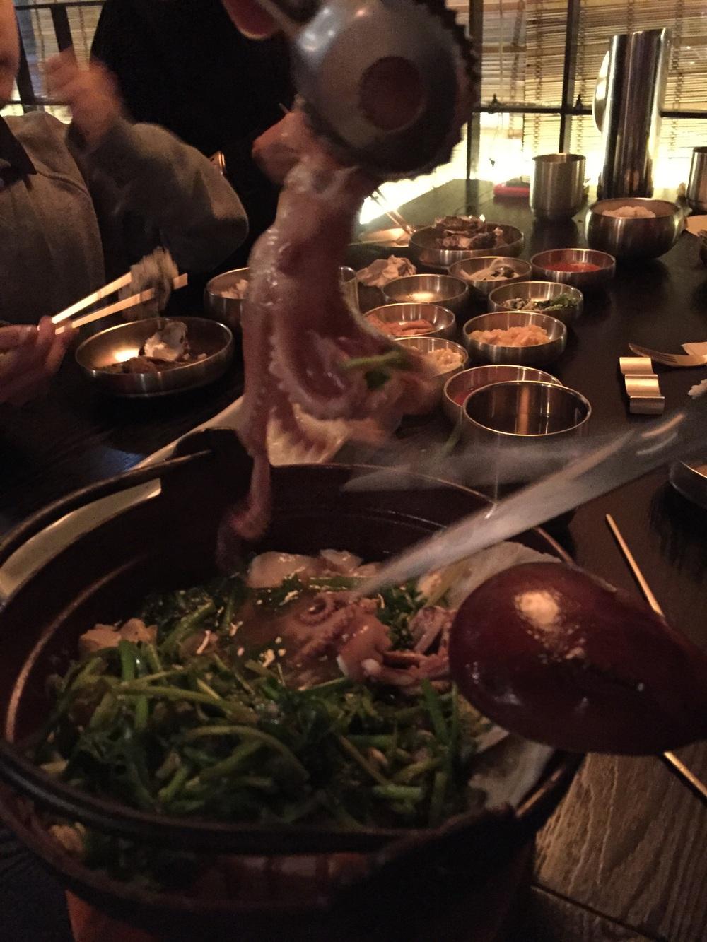 해물 백 순두부 탕 (HehMool Bek SoonDooBoo Tang) -  Seafood in a w  hite broth tofu soup. 40 000won  They cut up a small whole octopus into the soup at the table.