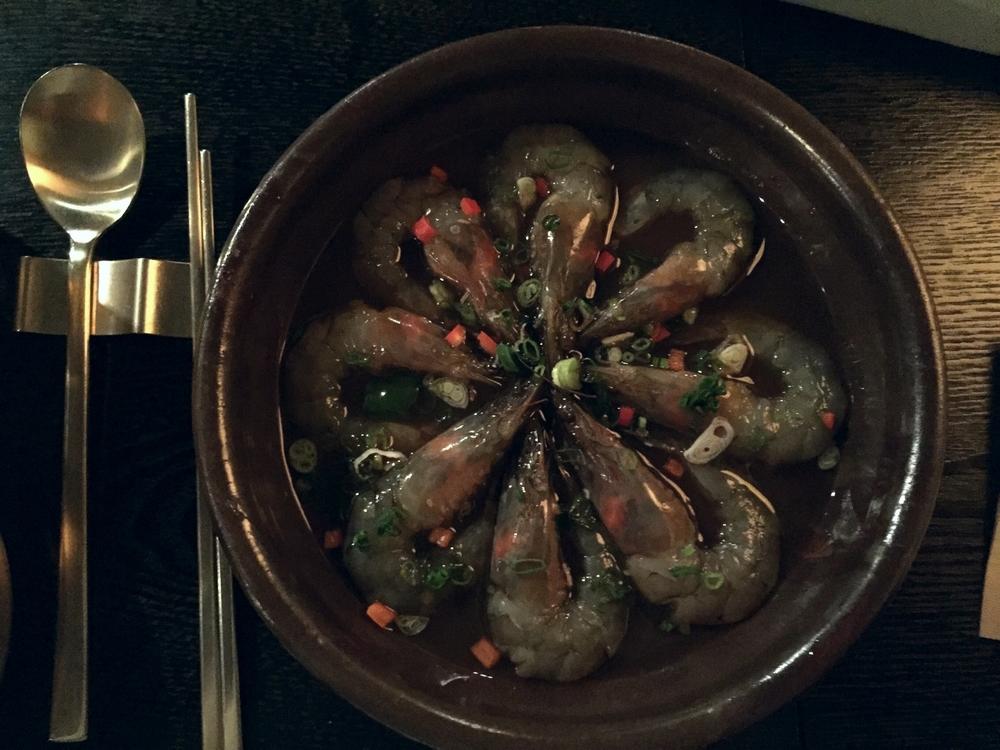 새우장 (SeWooJang) - Raw Prawns. 25 000won.  8 big succulent pieces of raw prawns that have been marinated in a savoury light soy sauce. The prawns were so fresh and firm. The sauce was light enough that it didn't overpower the taste of the prawns and was delicious on top of plain rice.
