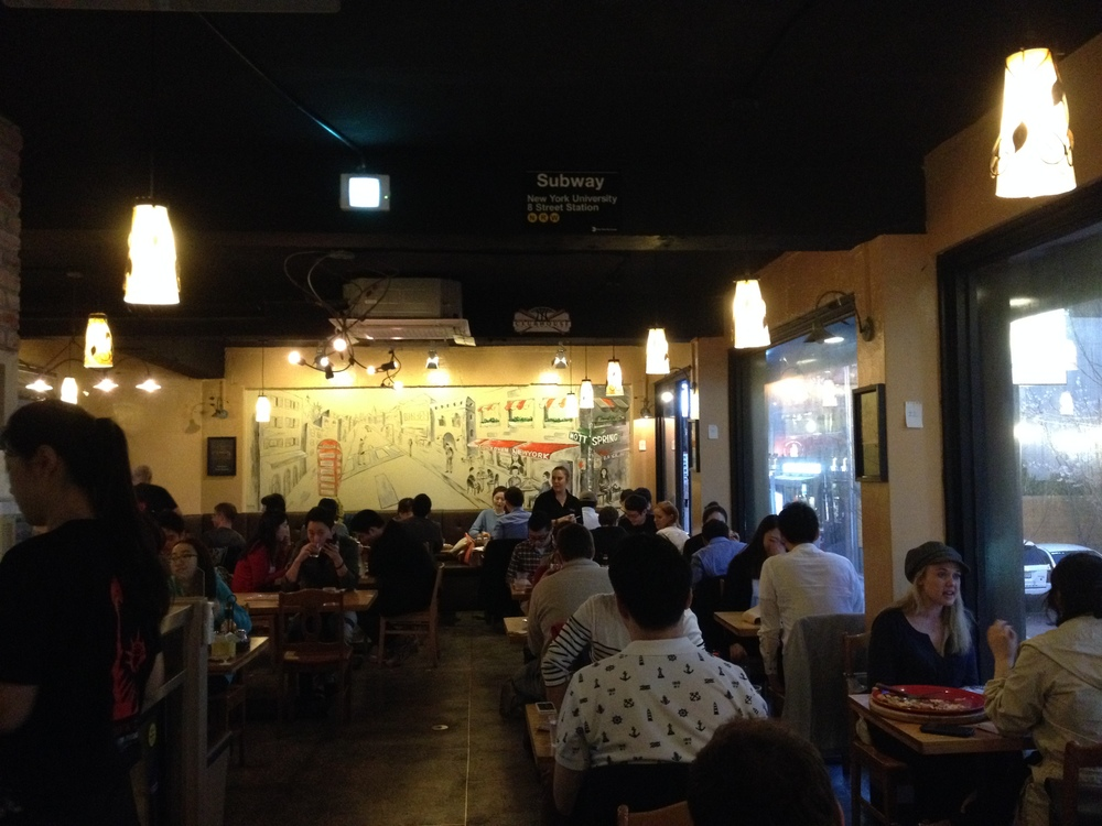 The inside is decorated with a simple style. Lots of pictures and articles of pizza places and scenes of NYC. It's a casual atmosphere and you go for the food!