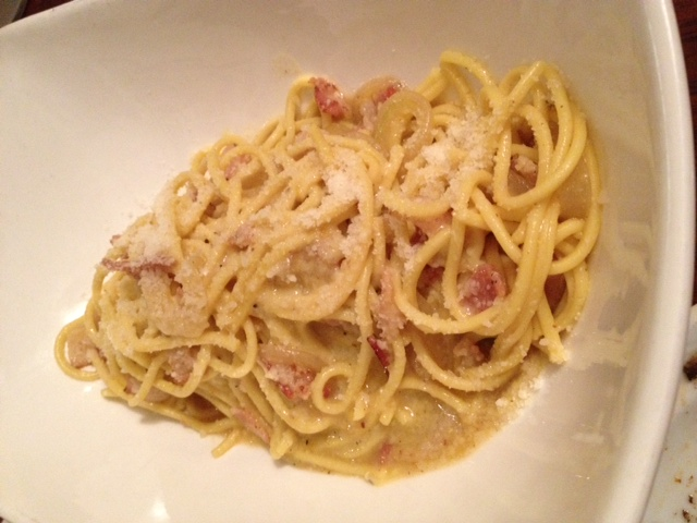 The original carbonara - made with just egg yolks, bacon, onions topped with fresh grated cheese on top.