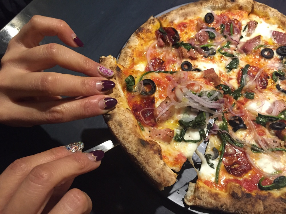Beautiful nails of owner at  @CocoLounge  modeling a slice of pie! Neapolitan pizza is a type of pizza that originated in Naples, Italy.