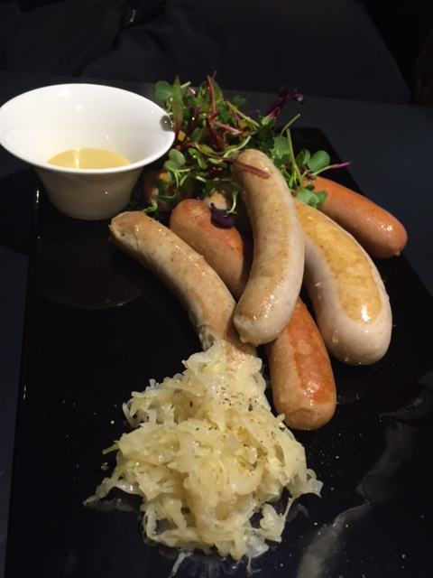 4 Sausage Platter - Grilled Chef Meili Krainer, Salzburg, Nuremberg and Italian Fennel Seed Sausage with Sauerkraut and mixed salad.