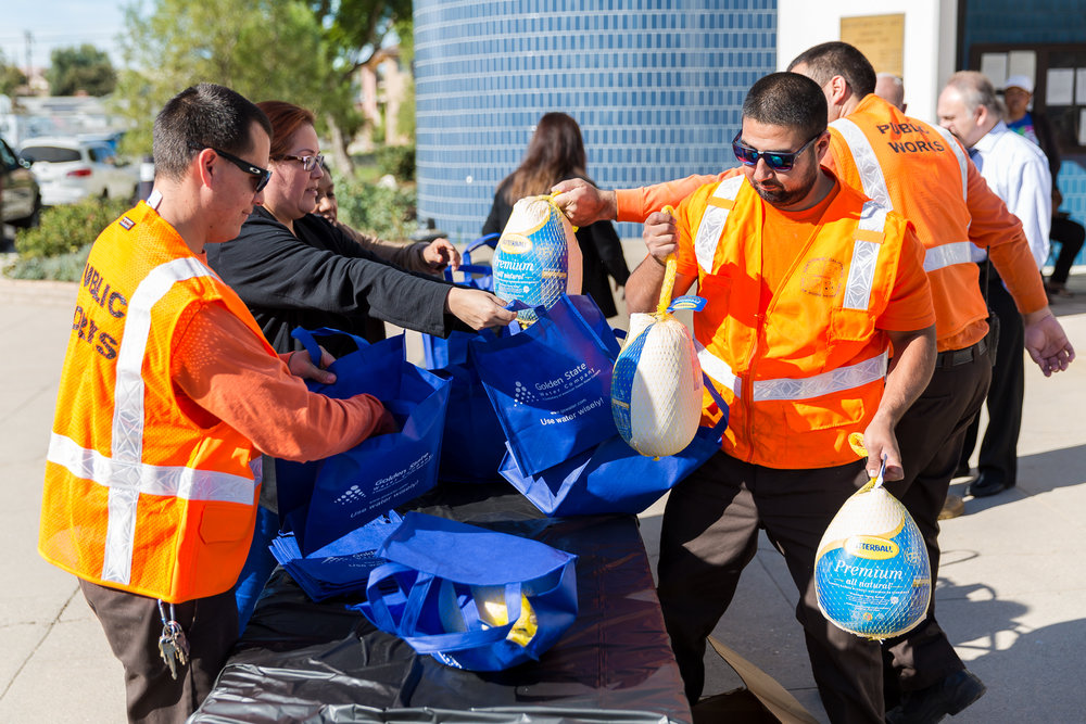 Public Works staff packing turkeys