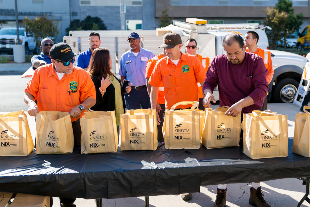 Public Works staff assembling bags for distribution
