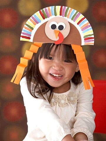 Make cute turkey hats out of paper plates and decorate them with colorful construction paper and paint! Pretend that your child is a turkey for the rest of the evening for an add-on make-believe game!