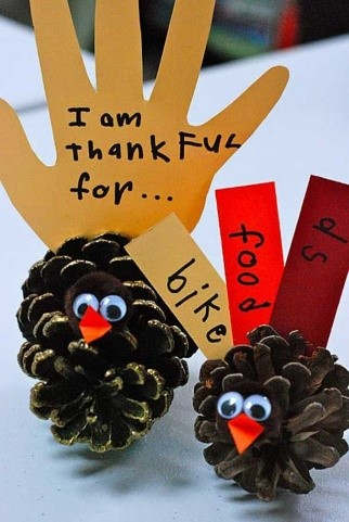 Kids sometimes say the darndest things!!! See all of the sweet and funny things that all of the little ones have to be grateful for this Thanksgiving season with a turkey centerpiece made out of pinecones, construction paper, small pieces of colorful felt fabric, and googly eyes.