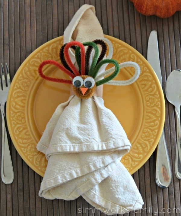 Get the youngins crafting while also having them help set the dinner table! Create this adorable and easy napkin holder using colorful pipe cleaners, googly eyes, and construction paper.   Leave us a comment telling us how your projects went, or share a fun story of a different project that you and your kids did to make Thanksgiving that much more special!!!