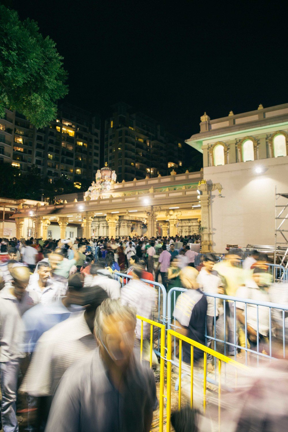 Devotees entering and exiting the temple.