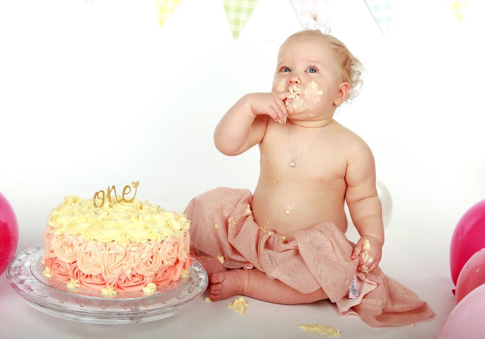 Ellie loving her cake Smash session. x