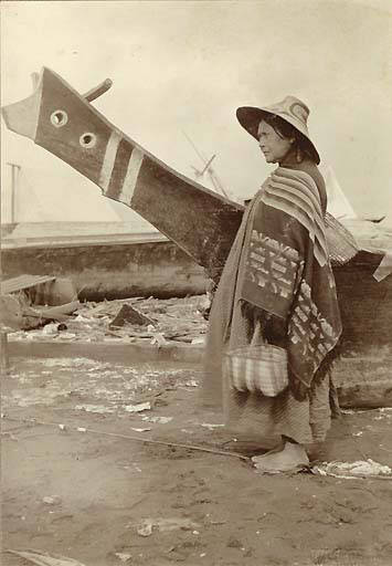 Indian_woman_and_canoe_at_the_Seattle_waterfront_1898.jpg