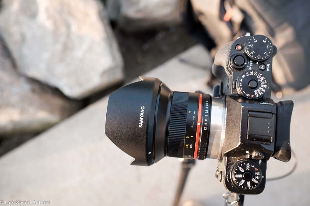 The aperture ring and focusing scale of the Samyang 12mm f/2.0 NCS CS