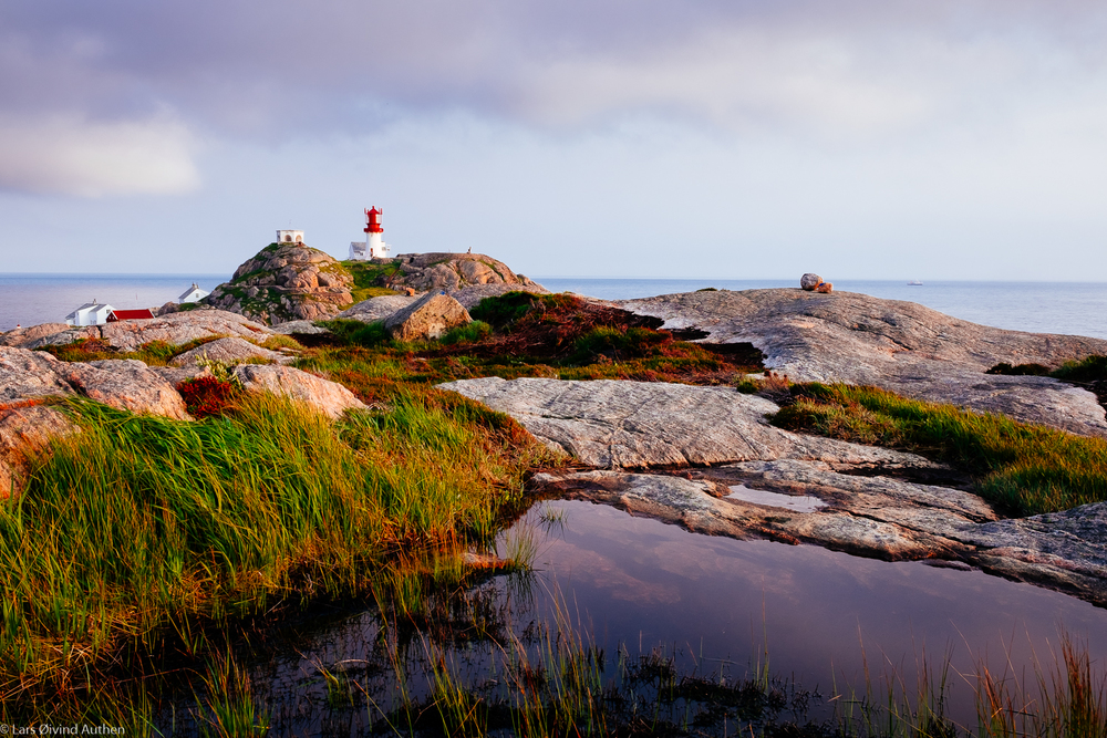Lindesnes Lighthouse at a distance, viewed from the north.Fujifilm X-T1 + XF 23mm f/1.4R, @ ISO 200, f/11, 1/45 sec. Lee polariserfilter. Benro tripod.