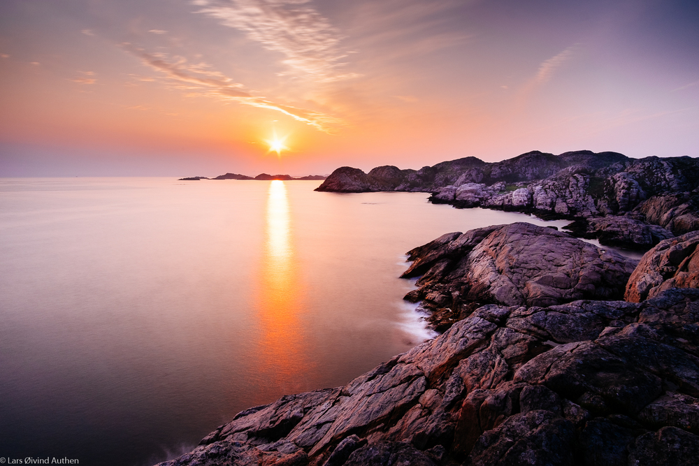 View from Lindesnes at sunset. Fujifilm X-T1 + Samyang 12mm NCS CS f/2.0 @ ISO 200, f/11, 25 sec. Lee Little Stopper (6 stop ND filter) +ND hard grad 0.6 filter (2 stops). Benro tripod.