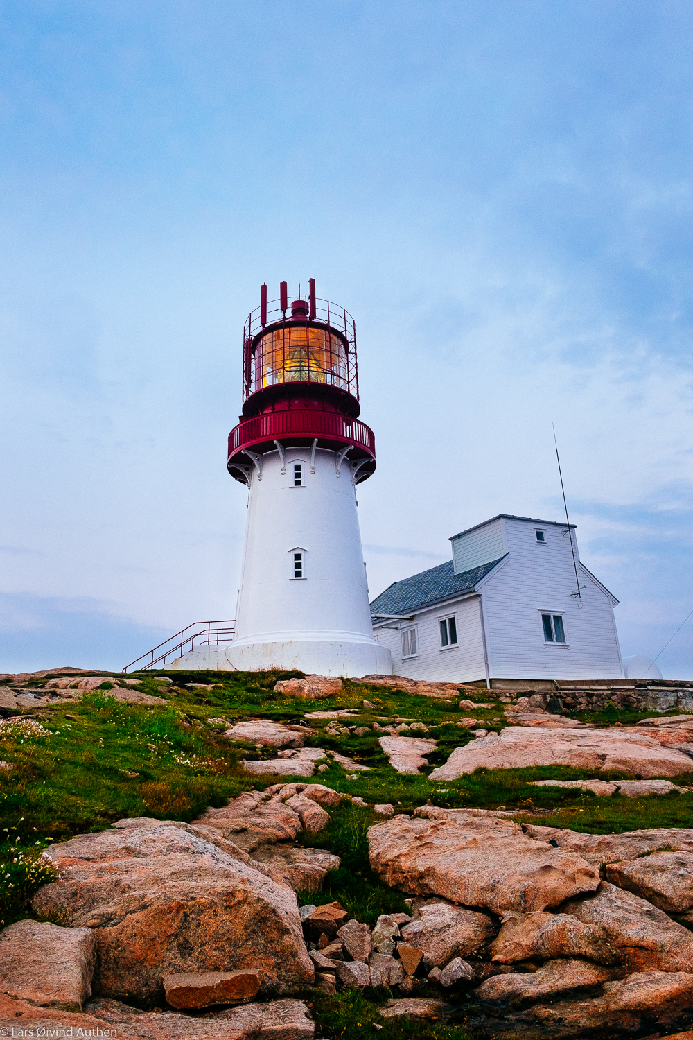Lindesnes Lighthouse before sunset. Fujifilm X-T1 + XF 14mm f/2.8 @ ISO 800, f5/.6, 1/60 sec. Handheld. No filters.