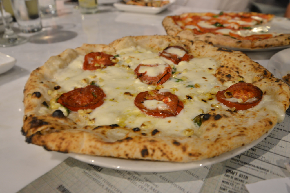 Corn and goat cheese give Settebello's Umbria pizza ($14) a nontraditional twist./ HEATHER GOLDIN, STAFF
