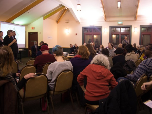 Boston 2024 executive committee members meet with residents at the Franklin Park Golf Clubhouse.