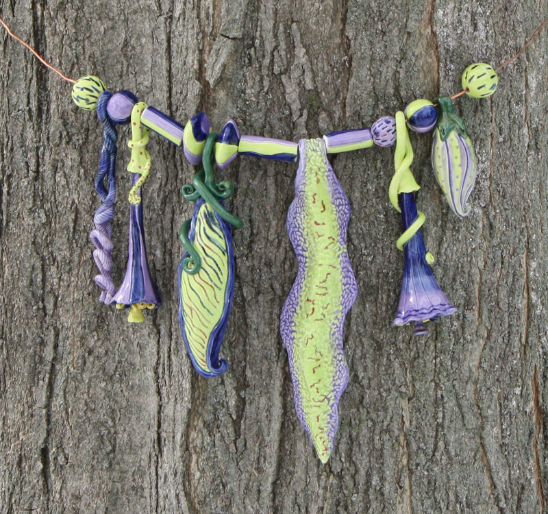 "Lime and mauve Tree Bling -Measures approx 20"" wide and the leaf is approx. 10"" long. $215.00. SOLD."