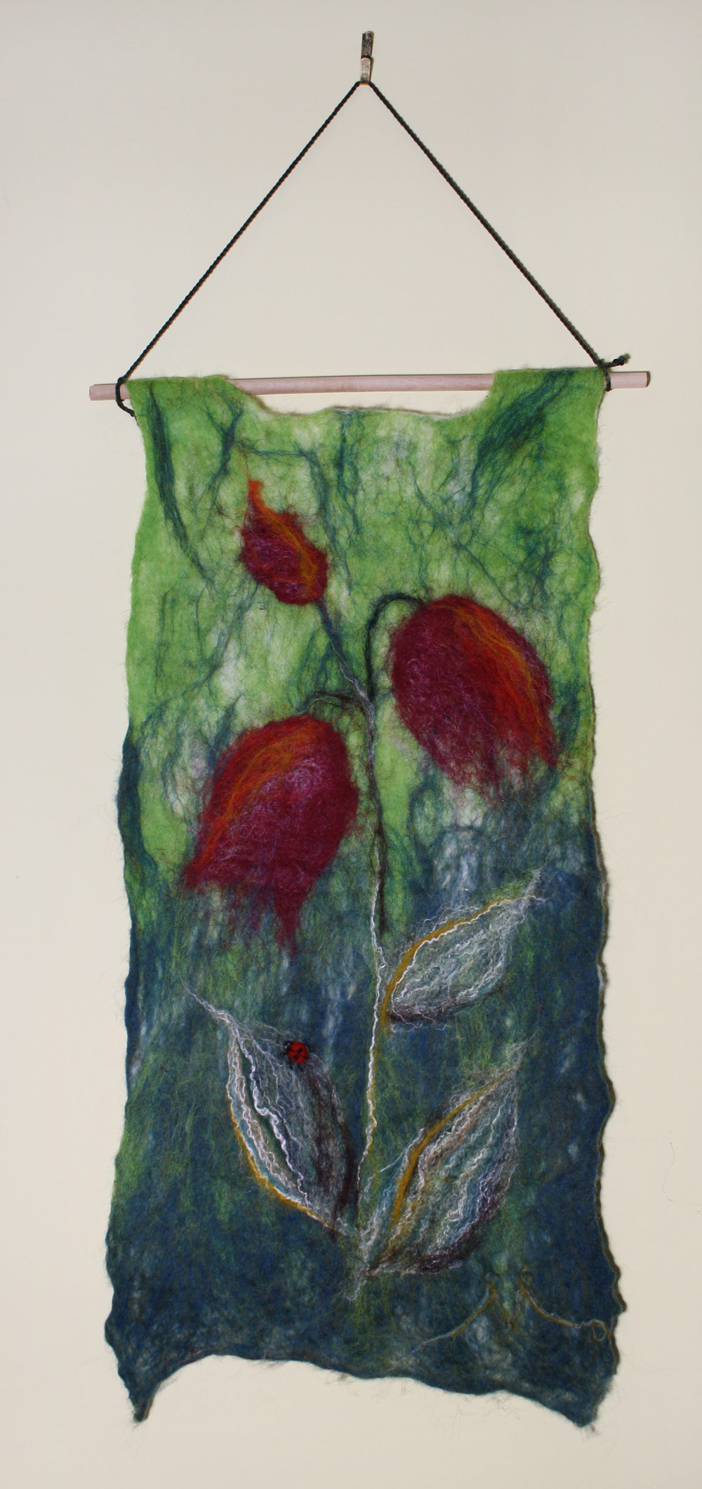 "Bellflower Ladybug Tapestry Wet felted tapestry of a bellflower in rich wine reds and oranges. Ladybug needled felted on leaf in relief. 9.75""w x 20""h to rod. SOLD."