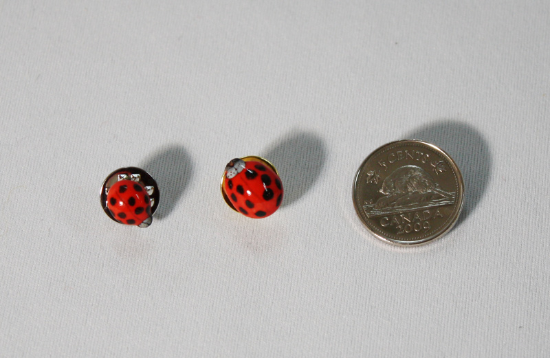 "2 sizes of ladybug pins: the smaller one is life-size and the other is a bit bigger at about 3/8"" long. To purchase a pin, please   contact me !"