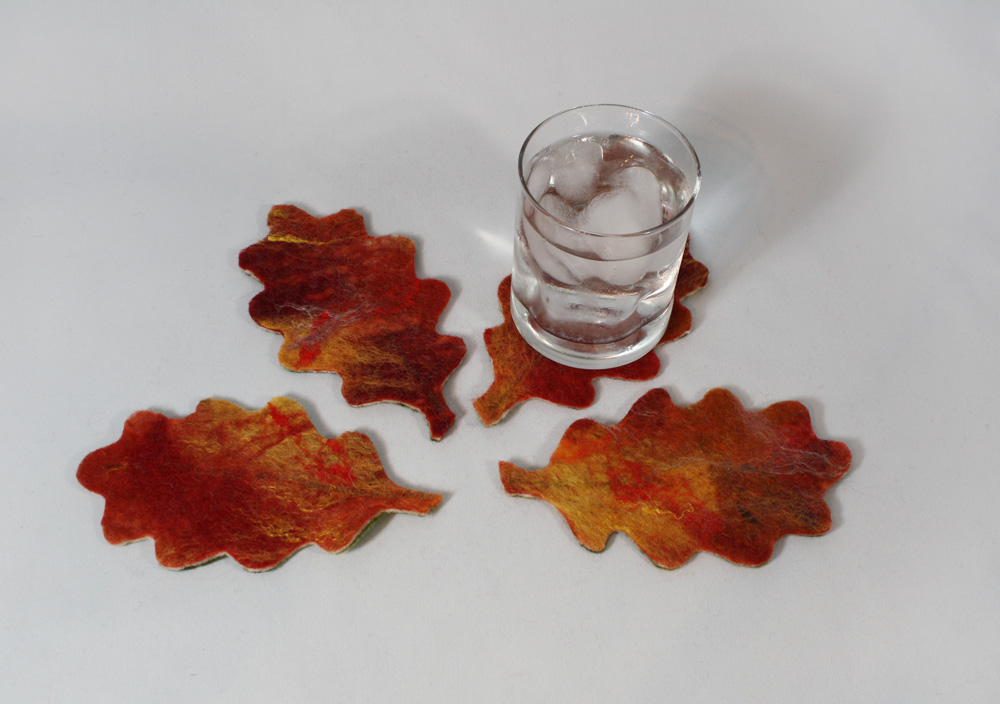 Oak Leaf all season coasters - reds and yellows on one side for fall and autumn entertaining; greens and yellows for spring and summer fun!  $39.00.  To purchase, please   contact me !
