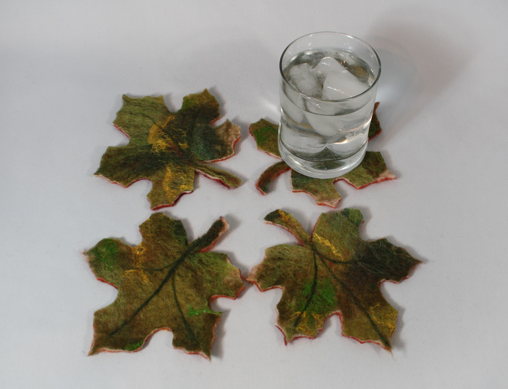 "Maple Leaf all season coasters - reds and yellows on one side for fall and autumn entertaining; greens and yellows for spring and summer fun! Visiting friends or relatives abroad? These make a truly unique ""made in Canada"" gift that's light-weight and easy to pack! $39.00. To purchase, click on photo."