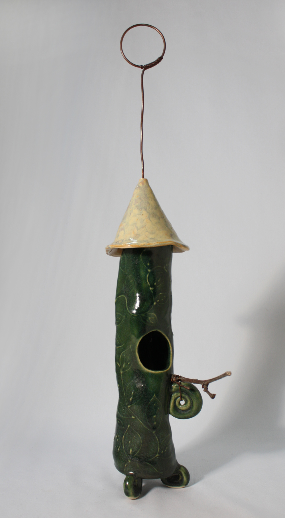 "Decorative Birdhouse with slip trailed vines. This one has ""attitude"" and a bit of a swagger! Dark green with a creamy coloured roof. $125 To purchase this one, please CONTACT ME."