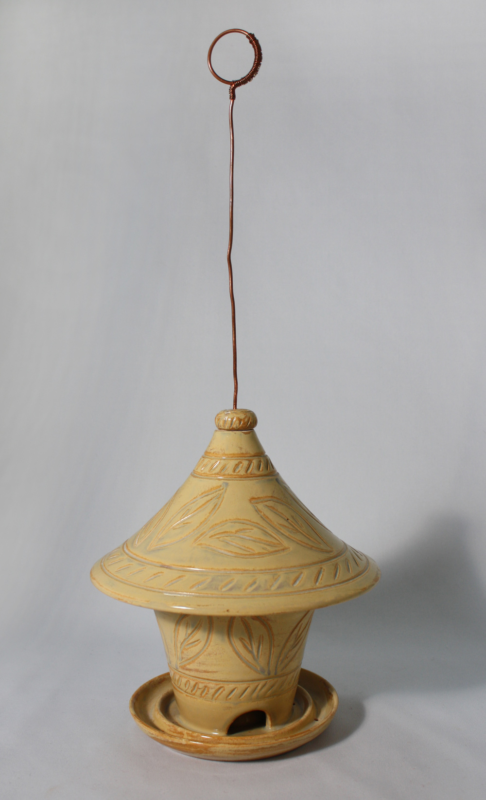 Creamy yellow bird feeder, hand carved. SOLD