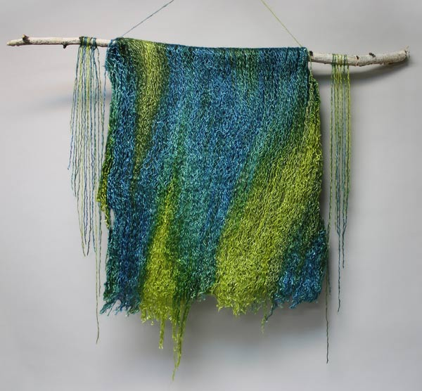 This felted piece of silk yarn and roving is called CASCADE. The shimmery silk adds to the wet look of the piece. This is part of the 2016 All Guilds Show at the AGB April 22-May 22, 2016.