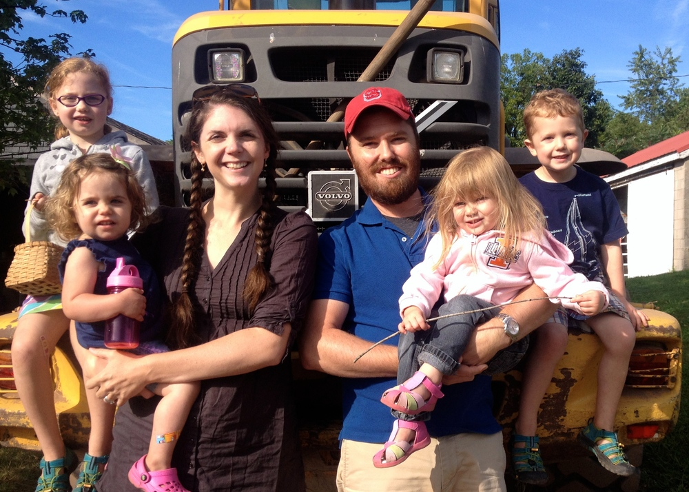 Got to get a family photo with the tractor! Caroline is apart of our bigger family... God's :)