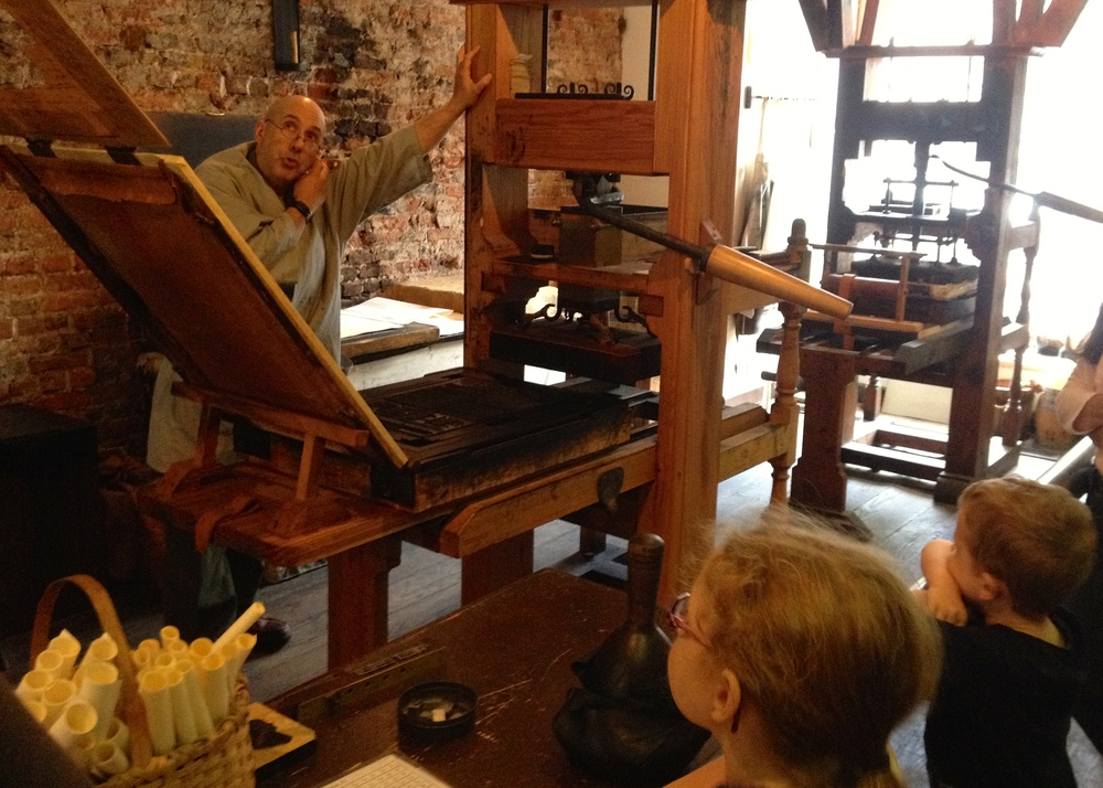 Learning all about Benjamin Franklin's printing press.