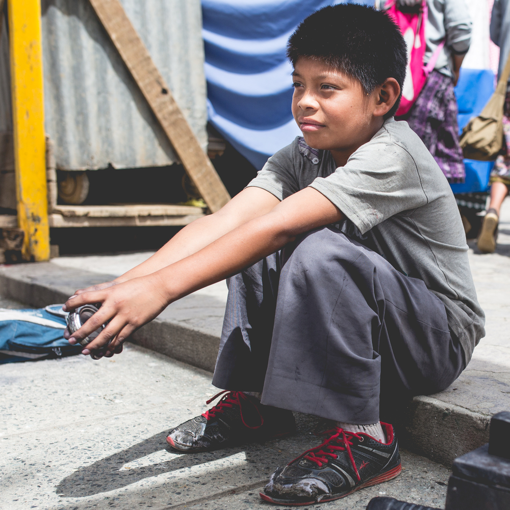 Edgar, age 13, used to shine shoes in the plaza to make money. Now, thanks to your support, he goes to school.