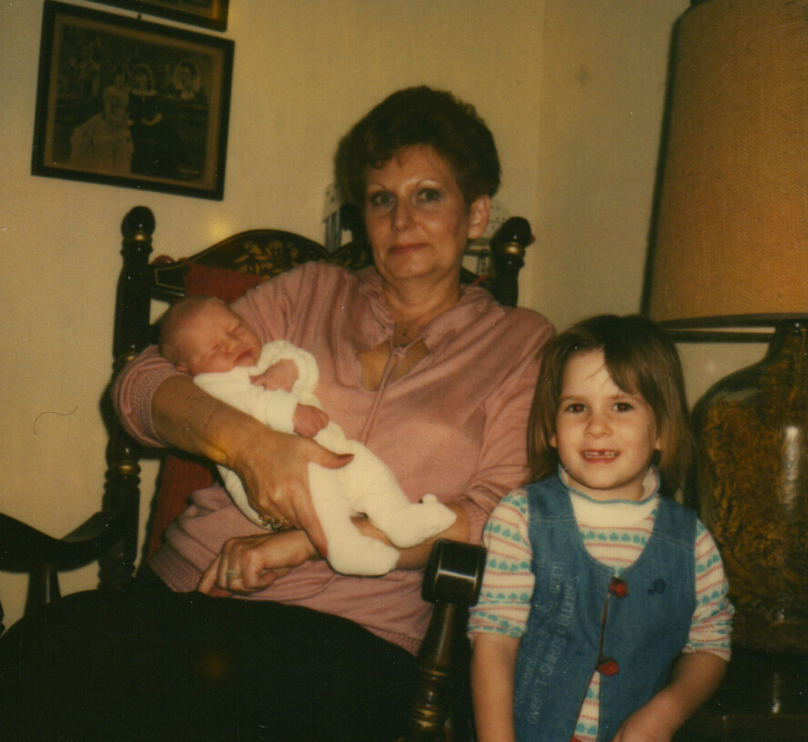 Mom with Morgan in her arms and Stacey on the right. 1981