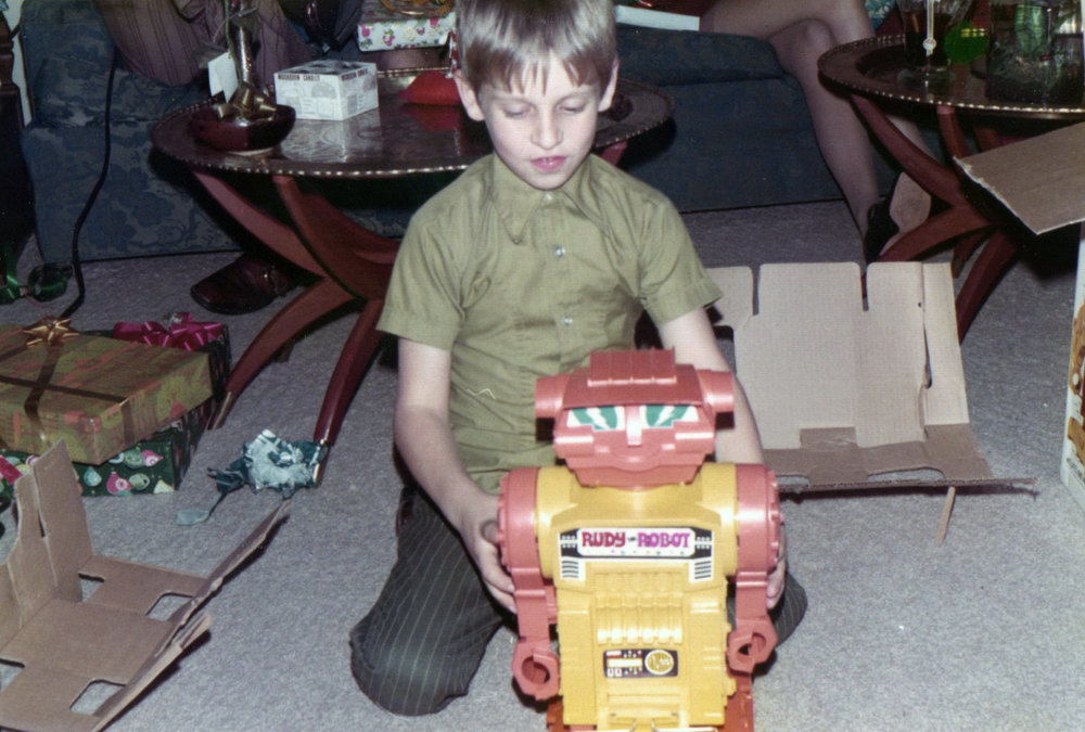 My youngest brother and the 'hot' toy of the year...Rudy the Robot. Est maybe Christmas 1970.