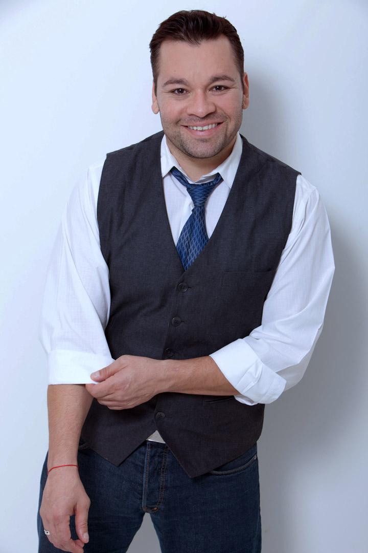 Eddie-112204- grey vest smiling.jpg