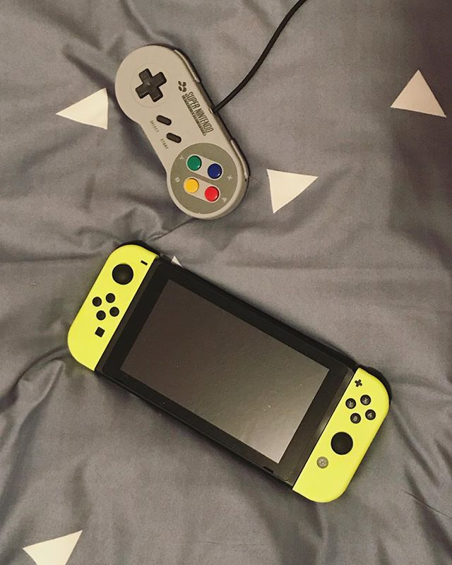 I had the realization today that I've given Nintendo thousands of dollars over my current lifetime. But how can anyone resist those neon yellow controllers?!