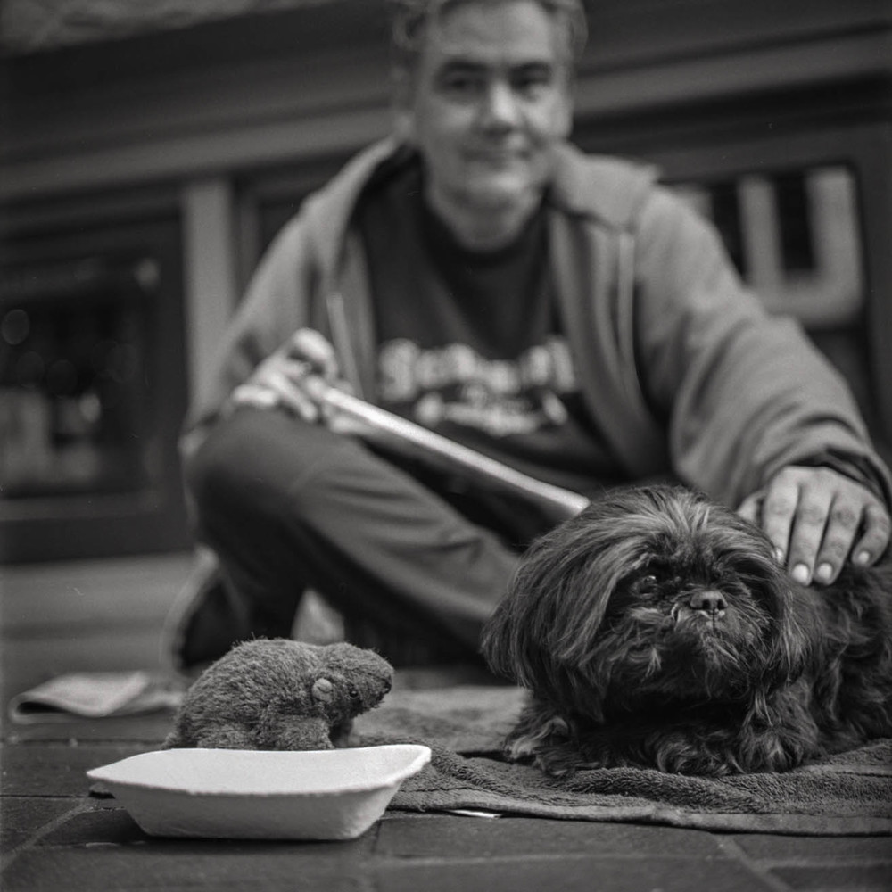 """""""He's blind in one eye"""" Gastown, Vancouver Rolleiflex 2.8C,Ilford Delta 100 8.16"""