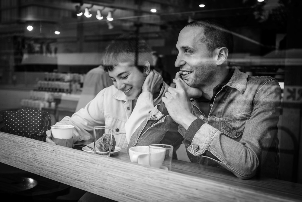 Couple in window Elysian Cafe,Vancouver Fuji X100T 8.16   About this photo