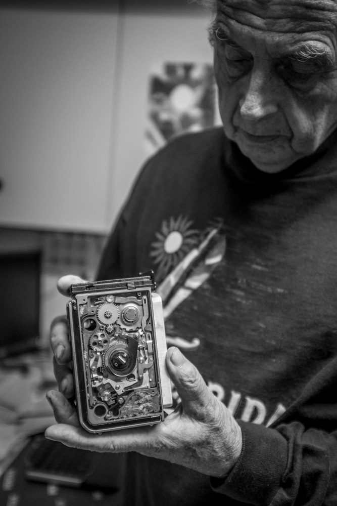 Horst Wenzel shows me the inner workings of the film advance system on a Rolleiflex camera that's over 50 years old.    Fuji X100T 9.16