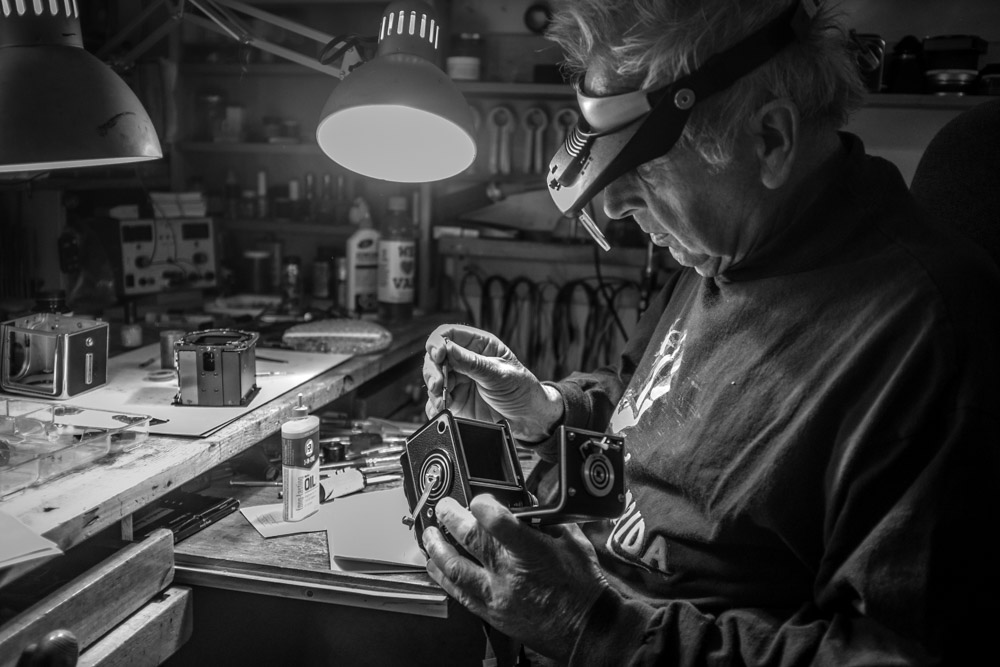 Horst Wenzel adds a small drop of lubricant to one of the rollers in my Rolleiflex 2.8C.    Fuji X100T 9.16