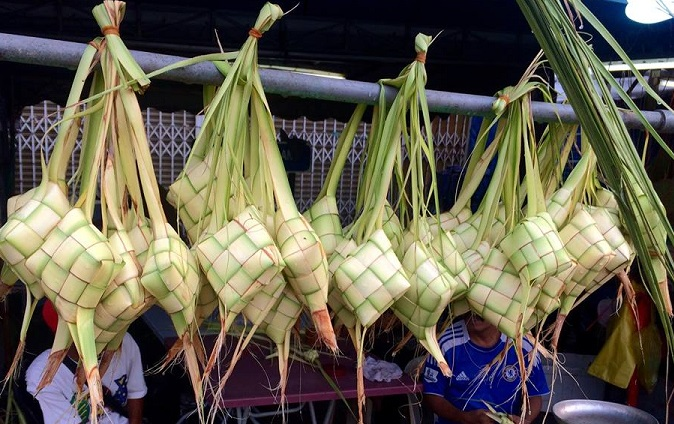 woven bamboo  ketupat  packets, ready to be steamed