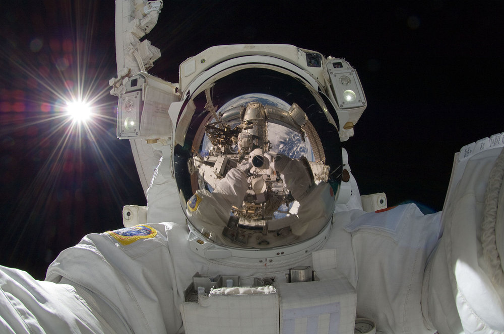 Hoshide taking a  space selfie  during extravehicular activity (EVA) on September 5, 2012, with the  Sun  behind him.
